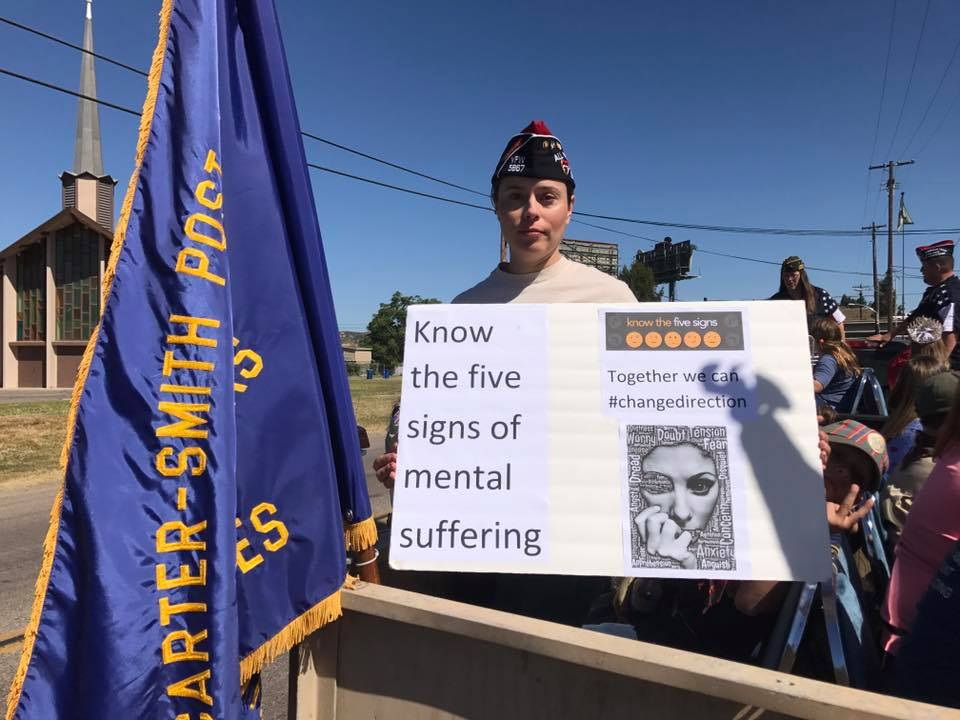 Comrade Miranda Williams holds a Change Direction/Stop the Stigma sign during the Lakeside Western Days Parade, April 2017. The goal of the Campaign to Change Direction is to change the culture of mental health in America so that all of those in need receive the care and support they deserve. The Campaign encourages all Americans to pay attention to their emotional well-being – and it reminds us that our emotional well-being is just as important as our physical well-being.